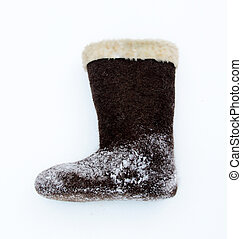 brown valenki - russian felt footwear on a snow