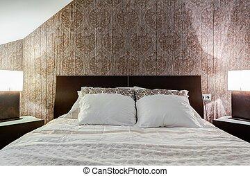 Brown wallpaper in elegant bedroom