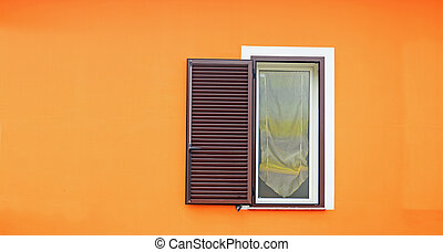 brown window in an orange wall