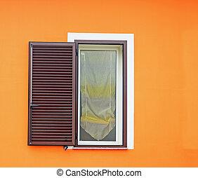 brown window in an orange wall