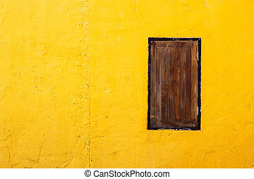 Brown window on orange concrete wall