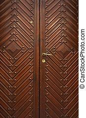 Brown wood old door in the centre of Lviv