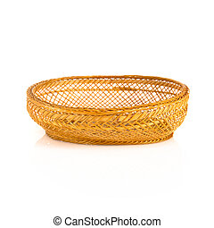Brown wooden basket over isolated white background