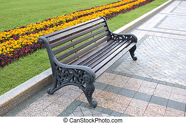 Brown wooden bench in a park