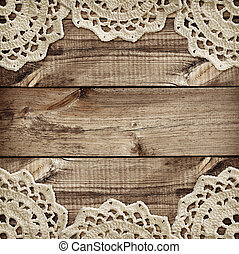Brown wooden board and small crochet doilies in borders