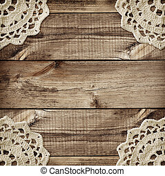 Brown wooden board and small crochet doilies in corners