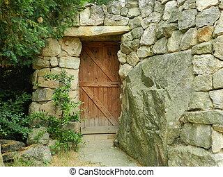 brown wooden door in a stone wall