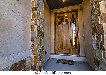 Brown wooden front door with panel windows
