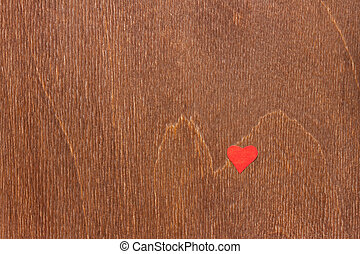 brown wooden surface with small red heart