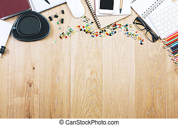 Top view and close up of brown wooden office table top with smartphone, supplies and other objects. Mock up