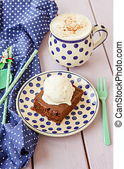 Chocolate brownie a la mode and a cup of coffee