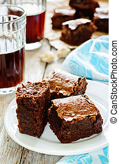 brownie on a white wood background. tinting. selective focus on the top of left brownie