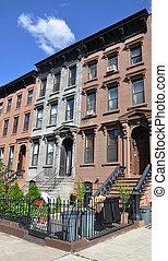 Brownstone homes in urban residential Brooklyn New York neighborhood