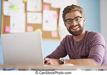 Browsing data on computer and looking at camera