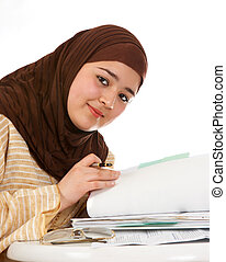 Browsing through files - Young islamic office worker...