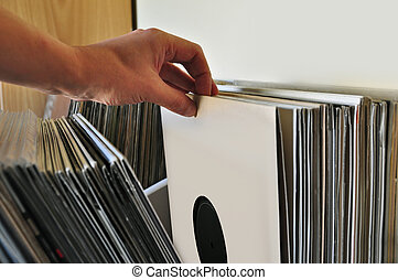 browsing vinyl records - Browsing through vinyl records...