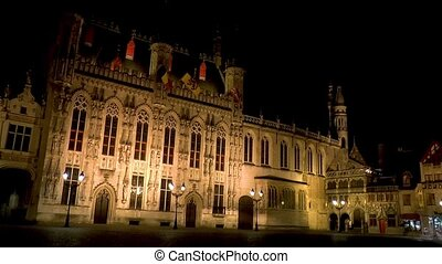 Night view of the Bruges City Hall building and Basilica of the Holy Blood, West Flanders, Belgium.