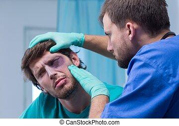 Injured man with bruise around the eye