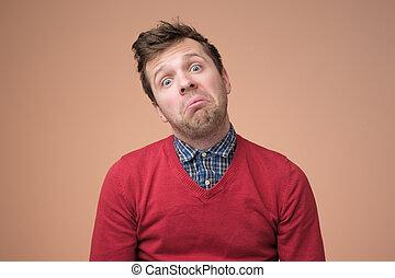 brun, fatigué, très, chandail, regarder, adulte, fond, homme, percé, sur, rouges, malade