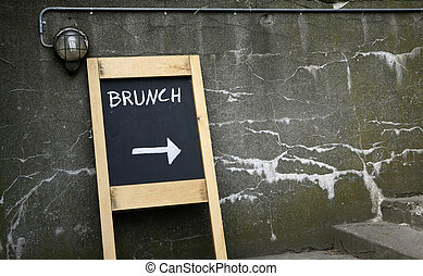 brunch this way - menu blackboard against the old wall