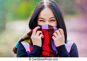 Brunet girl with colorful scarf