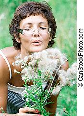brunet woman in a meadow