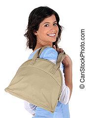 brunette all smiles with handbag