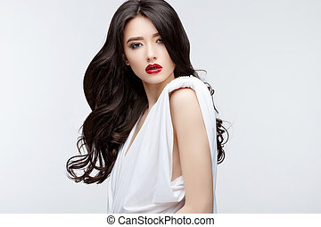 Brunette asian girl with long curly hair