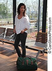 brunette at a train station
