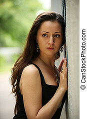 Brunette at a wall