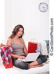 Brunette at home shopping online