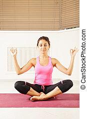 Brunette at meditation process