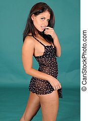 Brunette - Beautiful brunette in black lingerie against a...