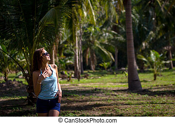 brunette beauty in a rain forest