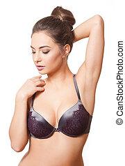Brunette beauty in elegant bra. - Portrait of young brunette...