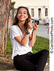 Brunette beauty taking photos. - Portrait of a young ...