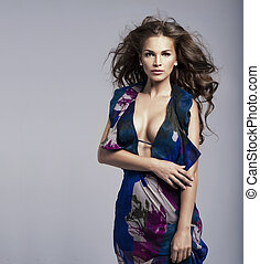 Brunette beauty wearing  dress