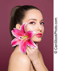 Brunette beauty with colorful flower.