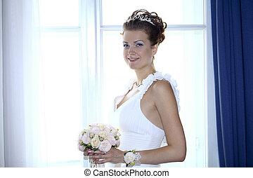 Brunette bride wearing wedding dress