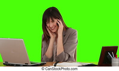 Brunette business woman laughing on the phone