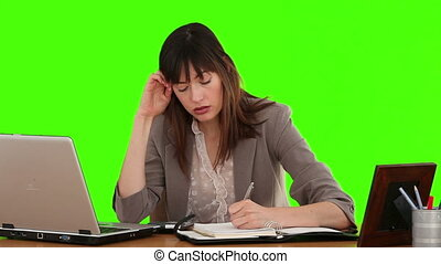 Brunette business woman nervous because she is calculating her bills