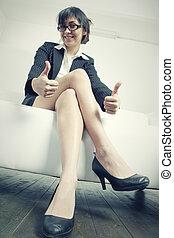 Brunette businesswoman both thumbs up