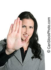 Brunette businesswoman hand stop sign