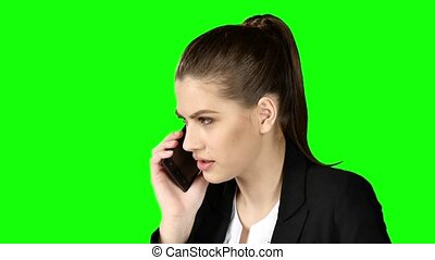 Brunette businesswoman hanging the phone angry. Green screen