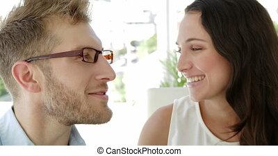 businesswoman kissing colleague - Brunette businesswoman...