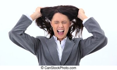 Brunette businesswoman pulling her hair against white...