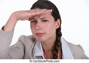 Brunette businesswoman saluting