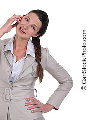Brunette businesswoman speaking to client over the phone