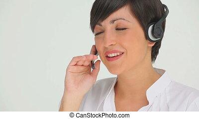 Brunette businesswoman talking on a headset