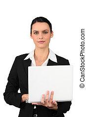 Brunette businesswoman with laptop